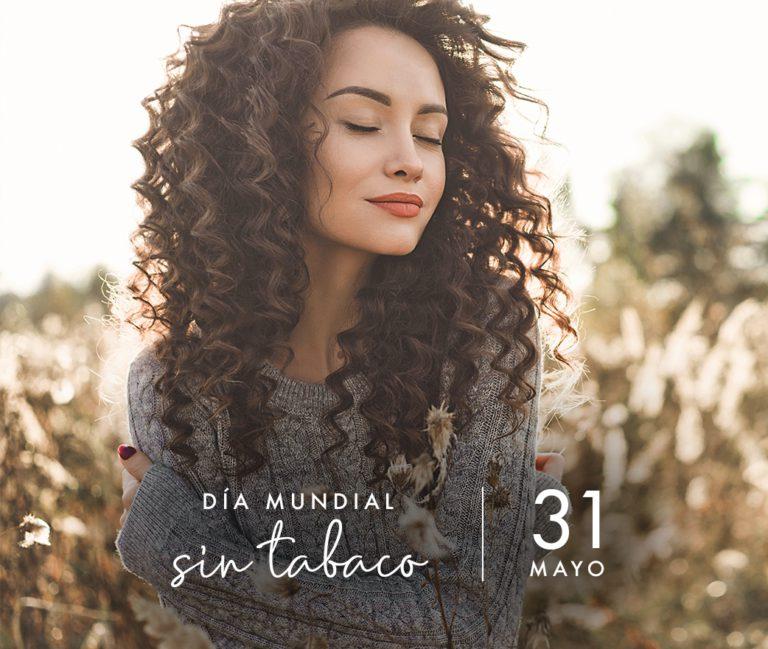 mujer en el campo feliz y pensado. Día mundial sin tabaco